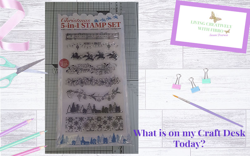 Living Creatively with Fibro | Christmas 5 in 1 stamp set on craft desk
