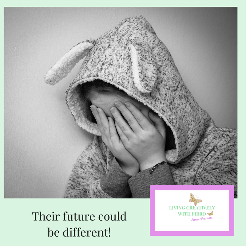 Living Creatively with Fibro | An image of a child sat covering their face and the message their future can be different