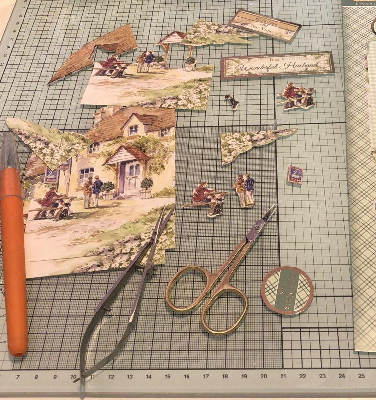 Living Creatively with Fibro | The Sections of decoupage removed from the sheet and spread over my craft desk with two pairs of decoupage and a craft knife.