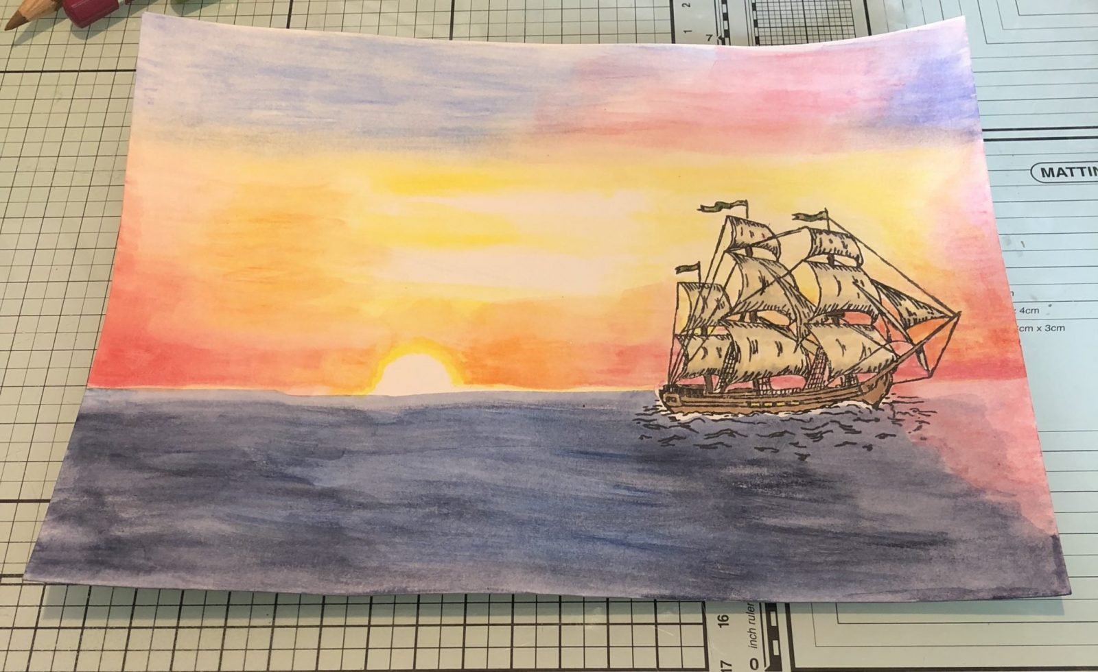 Living Creatively with Fibro | The ship with a watercolour background showing the sea with a sunset, using blues, yellow, orange, pink and red