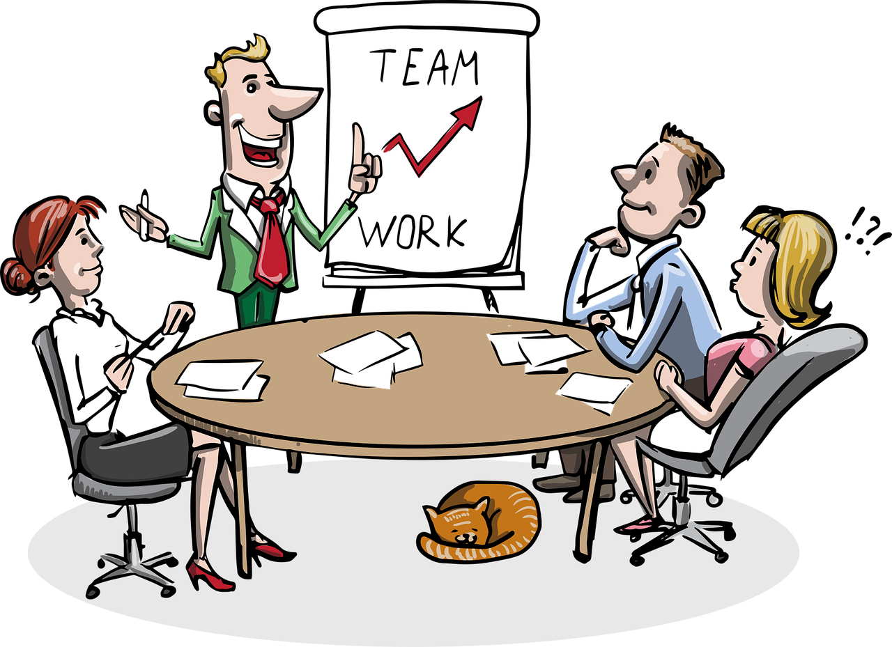 Living Creatively with Fibro   An illustration of a group of four people round a table with a flip-chart saying teamwork