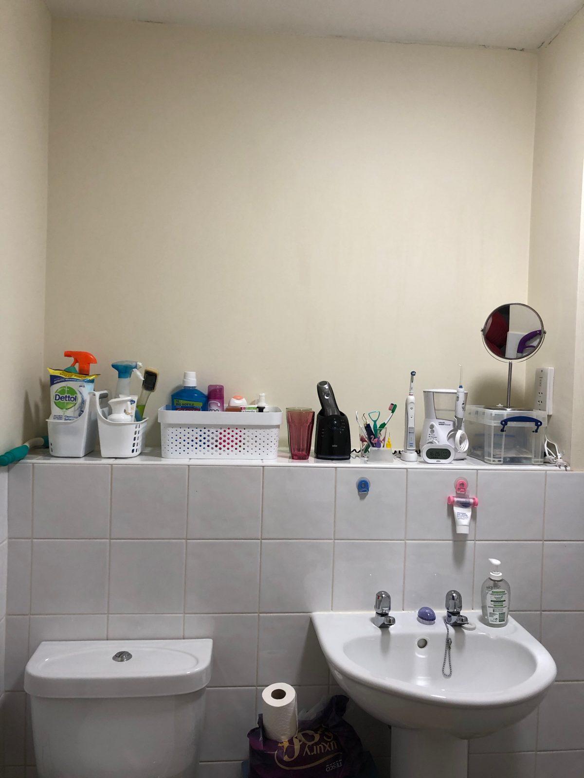 A Clean organised bathroom shelf