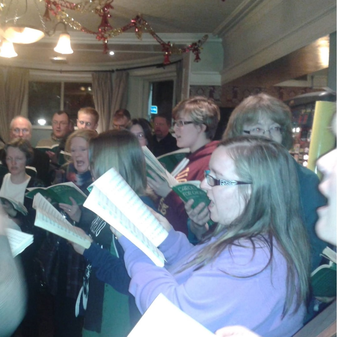 An image of me singing with my church choir during the festive season back in 2014